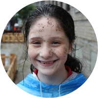 smiling girl with dirt on her face